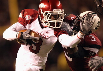 COLUMBIA, SC - NOVEMBER 06:  Joe Adams #3 of the Arkansas Razorbacks runs with the ball against Akeem Auguste #3 of the South Carolina Gamecocks during their game at Williams-Brice Stadium on November 6, 2010 in Columbia, South Carolina.  (Photo by Street