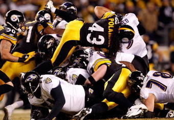 PITTSBURGH - JANUARY 18:  Troy Polamalu #43 of the Pittsburgh Steelers and the Steeler defense stop quarterback Joe Flacco #5 of the Baltimore Ravens on a 4th and 1 play during the AFC Championship game on January 18, 2009 at Heinz Field in Pittsburgh, Pe