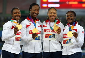 DAEGU, SOUTH KOREA - SEPTEMBER 04:  (L-R) Carmelita Jeter, Marshevet Myers, Allyson Felix and Bianca Knight of the USA pose with their gold medals during the medal ceremony for the women's 4x100 metres relay final during day nine of 13th IAAF World Athlet