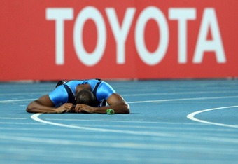 DAEGU, SOUTH KOREA - SEPTEMBER 04:  Darvis Patton of the USA lies on the track after falling during the men's 4x100 metres relay final during day nine of 13th IAAF World Athletics Championships at Daegu Stadium on September 4, 2011 in Daegu, South Korea.