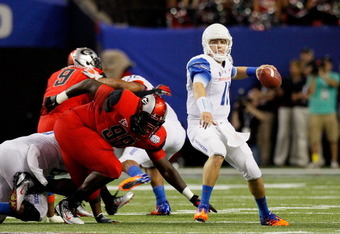 ATLANTA, GA - SEPTEMBER 03:  Kellen Moore #11 of the Boise State Broncos looks to pass against the Georgia Bulldogs at Georgia Dome on September 3, 2011 in Atlanta, Georgia.  (Photo by Kevin C. Cox/Getty Images)