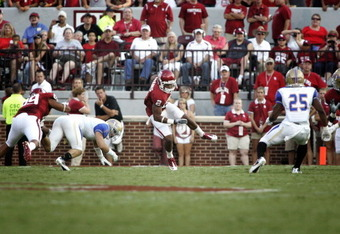 NORMAN, OK - SEPTEMBER 03:   Wide receiver Trey Franks tries to keep his feet in the first half against the Tulsa Hurricanes September 3, 2011 at Gaylord Family-Oklahoma Memorial Stadium in Norman, Oklahoma.  Oklahoma defeated Tulsa 47-14.  (Photo by Bret
