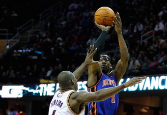 CLEVELAND, OH - FEBRUARY 25:  Amar'e Stoudemire #1 of the New York Knicks goes up for a shot over Antawn Jamison #4 of the Cleveland Cavaliers during the game on February 25, 2011 at Quicken Loans Arena in Cleveland, Ohio. NOTE TO USER: User expressly ack
