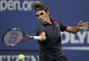 NEW YORK, NY - SEPTEMBER 05:  Roger Federer of Switzerland hits a forehand against Juan Monacoof Argentina during Day Eight of the 2011 US Open at the USTA Billie Jean King National Tennis Center on September 5, 2011 in the Flushing neighborhood of the Qu