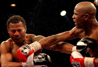 LAS VEGAS - MAY 01: (R-L) Floyd Mayweather Jr. throws a right to the head of Shane Mosley during their welterweight fight at the MGM Grand Garden Arena on May 1, 2010 in Las Vegas, Nevada. Mayweather Jr. defeated Mosley by unanimous decison. (Photo by Jed