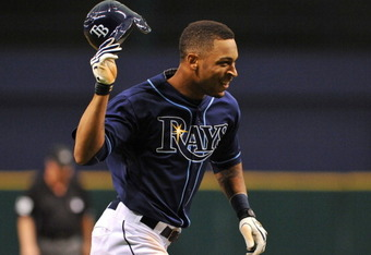 ST. PETERSBURG, FL - SEPTEMBER 07:  Outfielder Desmond Jennings #8 of the Tampa Bay Rays celebrates a 10th-inning, game-winning home run against the Texas Rangers September 7, 2011 at Tropicana Field in St. Petersburg, Florida.  The Rays won 5 - 4. (Photo
