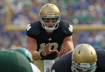 SOUTH BEND, IN - SEPTEMBER 03:  Dayne Crist #10 of the Notre Dame Fighting Irish awaits the snap against the University of South Florida Bulls at Notre Dame Stadium on September 3, 2011 in South Bend, Indiana. South Florida defeated Notre Dame 23-20. (Pho