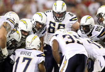 GLENDALE, AZ - AUGUST 27:  The San Diego Chargers huddle up around quarterback Philip Rivers #17 during the preseason NFL game against the Arizona Cardinals at the University of Phoenix Stadium on August 27, 2011 in Glendale, Arizona.  The Chargers defeat