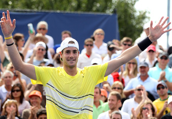 NEW YORK, NY - SEPTEMBER 08:  John Isner of the United States reacts after defeating Gilles Simon of France during Day Eleven of the 2011 US Open at the USTA Billie Jean King National Tennis Center on September 8, 2011 in the Flushing neighborhood of the