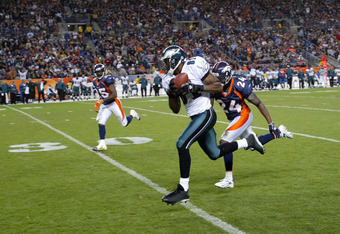 DENVER - OCTOBER 30:  Terrell Owens #81 of the Philadelphia Eagles goes 46 yards for a third quarter first down on a pass from Donovan McNabb and is brought down by Champ Bailey #24 of the  Denver Broncos as the Broncos defeated the Eagles 49-21 on Octobe