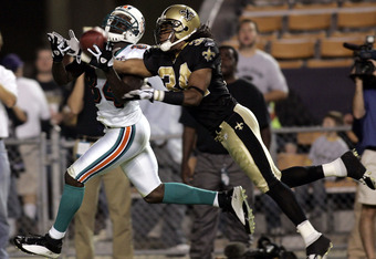 BATON ROUGE, LA - OCTOBER 30:   Mike McKenzie #34 of the New Orleans Saints breaks up a pass intended for Chris Chambers #84 of the Miami Dolphins on October 30, 2005 at Tiger Stadium on the Louisiana State University campus in Baton Rouge, Louisiana.  Th