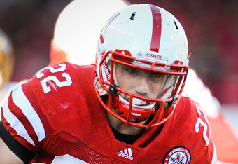 LINCOLN, NE - NOVEMBER 26: Rex Burkhead #22 of the Nebraska Cornhuskers powers through the Colorado Buffalo defense during their game at Memorial Stadium on November 26, 2010 in Lincoln, Nebraska. Nebraska defeated Colorado 45-17 (Photo by Eric Francis/Ge