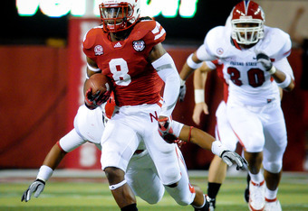 LINCOLN, NE - SEPTEMBER 10: Ameer Abdullah #8 of the Nebraska Cornhuskers runs a kickoff back for a second half touchdown during their game at Memorial Stadium September 10, 2011 in Lincoln, Nebraska. Nebraska won 42-29.(Photo by Eric Francis/Getty Images