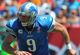 TAMPA, FL - SEPTEMBER 11:  Quarterback Matthew Stafford #9 of the Detroit Lions runs with the ball against the Tampa Bay Buccaneers during the season opener at Raymond James Stadium September 11, 2011 in Tampa, Florida. (Photo by Al Messerschmidt/Getty Im