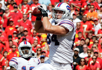 KANSAS CITY, MO - SEPTEMBER 11:  Scott Chandler #84 of the Buffalo Bills makes a catch for a touchdown during the game against the Kansas City Chiefs at Arrowhead Stadium on September 11, 2011 in Kansas City, Missouri.  (Photo by Jamie Squire/Getty Images
