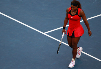 NEW YORK, NY - SEPTEMBER 11:  Serena Williams of the United States reacts while playing against Samantha Stosur of Australia during the Women's Singles Final on Day Fourteen of the 2011 US Open at the USTA Billie Jean King National Tennis Center on Septem