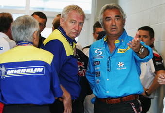 INDIANAPOLIS - JUNE 19:  Team Principle Flavio Briatore of Renault with Nick Sherrock of Michelin talk after team meetings were held to decide whether the race would go ahead during the United States F1 Grand Prix at the Indianapolis Motor Speedway on Jun