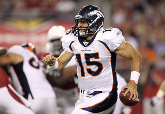 GLENDALE, AZ - SEPTEMBER 01:  Quarterback Tim Tebow #15 of the Denver Broncos scrambles with the football during the preseason NFL game against the Arizona Cardinals at the University of Phoenix Stadium on September 1, 2011 in Glendale, Arizona.  The Card