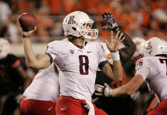 STILLWATER, OK - SEPTEMBER 8:  Quarterback Nick Foles #8 of the Arizona Wildcats prepares to throw during the second half against the Oklahoma State Cowboys on September 8, 2011 at Boone Pickens Stadium in Stillwater, Oklahoma.  Oklahoma State defeated Ar