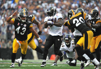 BALTIMORE, MD - SEPTEMBER 11:  Ricky Williams #34 of the Baltimore Ravens runs the ball against the Pittsburgh Steelers at M&T Bank Stadium on September 11, 2011 in Baltimore, Maryland. The Ravens defeated the Steelers 35-7. (Photo by Larry French/Getty I
