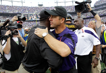 BALTIMORE, MD - SEPTEMBER 11: Head coaches John Harbaugh (R) of the Baltimore Ravens talks with Mike Tomlin of the Pittsburgh Steelers  (R) following the Ravens 35-7 win during the season opener at M&T Bank Stadium on September 11, 2011 in Baltimore, Mary