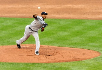BALTIMORE, MD- SEPTEMBER 8:  Starting pitcher Ivan Nova #47 of the New York Yankees pitches against the Baltimore Orioles at Oriole Park at Camden Yards on September 8, 2011 in Baltimore, Maryland. The Orioles beat the Yankees 5-4 in 10 innings. (Photo by