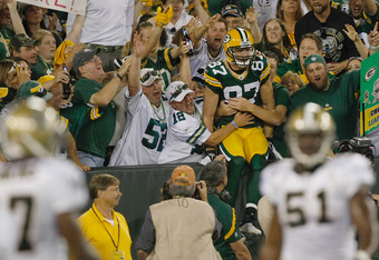 GREEN BAY, WI - SEPTEMBER 8: Jordy Nelson #87 of the Green Bay Packers jumps in the stands after scoring a touchdown during the game against the New Orleans Saints at Lambeau Field on September 8, 2011 in Green Bay, Wisconsin. (Photo by Scott Boehm/Getty