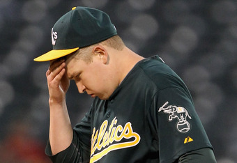OAKLAND, CA - JULY 05:  Trevor Cahill #53 of the Oakland Athletics rubs his head in the seventh inning after giving up a home run to Dustin Ackley #13 of the Seattle Mariners at Oakland-Alameda County Coliseum on July 5, 2011 in Oakland, California.  (Pho