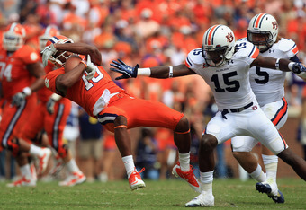 CLEMSON, SC - SEPTEMBER 17:  Jaron Brown #18 of the Clemson Tigers is tackled as he makes a catch by Neiko Thorpe #15 of the Auburn Tigers during their game at Memorial Stadium on September 17, 2011 in Clemson, South Carolina.  (Photo by Streeter Lecka/Ge