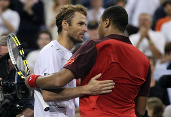 NEW YORK, NY - SEPTEMBER 05:  Jo-Wilfried Tsonga (R) of France shakes hands with Mardy Fish (L) of the United States after their match during Day Eight of the 2011 US Open at the USTA Billie Jean King National Tennis Center on September 5, 2011 in the Flu