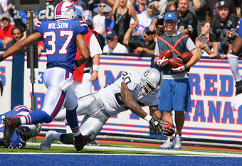 ORCHARD PARK, NY - SEPTEMBER 18: Darren McFadden #20 of the Oakland Raiders reaches over the goal line to score Oakland's second touchdown against the Buffalo Bills at Ralph Wilson Stadium on September 18, 2011 in Orchard Park, New York.  (Photo by Rick S