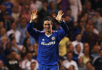LONDON, ENGLAND - APRIL 23:  Fernando Torres of Chelsea celebrates after scoring his first goal for the club and his team's second during the Barclays Premier League match between Chelsea and West Ham United at Stamford Bridge on April 23, 2011 in London,