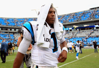 Cam Newton, and his BFF: the towel
