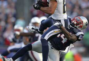 FOXBORO, MA -  SEPTEMBER 18:     Vincent Jackson #83 of the San Diego Chargers is stopped by  Kyle Arrington #24 of the New England Patriots in the first half at Gillette Stadium on September 18, 2011 in Foxboro, Massachusetts. (Photo by Jim Rogash/Getty