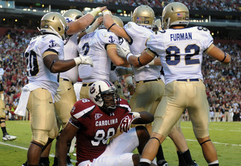 COLUMBIA, SC - SEPTEMBER 17:  Quarterback Kriss Proctor #2 of Navy Midshipmen celebrates a touchdown run over defensive end Devin Taylor #98 of the South Carolina Gamecocks September 17, 2011 at Williams-Brice Stadium in Columbia, South Carolina.  (Photo