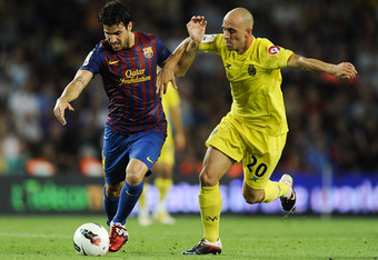 BARCELONA, SPAIN - AUGUST 29:  Cesc Fabregas of FC Barcelona (L) competes with Borja Valero of Villarreal CF during the La Liga match between FC Barcelona and Villarreal CF at Camp Nou on August 29, 2011 in Barcelona, Spain.  (Photo by David Ramos/Getty I