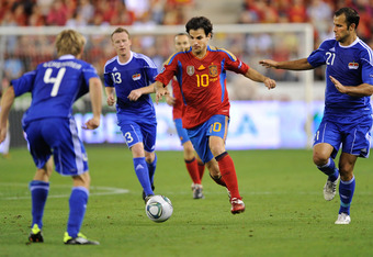 LOGRONO, SPAIN - SEPTEMBER 06: Cesc Fabragas (C) of Spain takes on Martin Rechsteiner of Liechtenstein during the EURO 2012 Qualifier match between Spain and Liechtenstein at estadio Las Gaunas on September 6, 2011 in Logrono, Spain.  (Photo by Denis Doyl