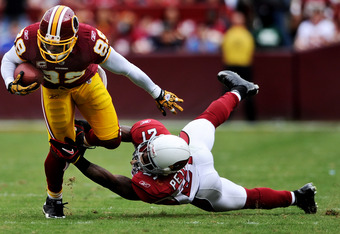 LANDOVER, MD - SEPTEMBER 18: Wide receiver Santana Moss #89 of the Washington Redskins eludes corner back Patrick Peterson #21 of the Arizona Cardinals during the third quarter at FedExField on September 18, 2011 in Landover, Maryland. The Washington Reds
