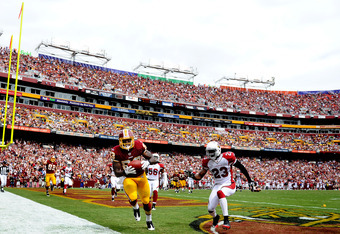 LANDOVER, MD - SEPTEMBER 18: Tight end Fred Davis #83 of the Washington Redskins pulls in a touchdown pass over safety Hamza Abdullah #23 of the Arizona Cardinals during the second quarter at FedExField on September 18, 2011 in Landover, Maryland. (Photo