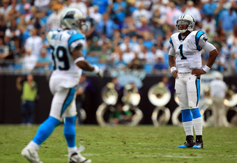 CHARLOTTE, NC - SEPTEMBER 18:   Cam Newton #1 of the Carolina Panthers and Steve Smith #89 of the Carolina Panthers during their game against the Green Bay Packers at Bank of America Stadium on September 18, 2011 in Charlotte, North Carolina.  (Photo by S