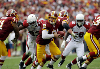 LANDOVER, MD - SEPTEMBER 18:  Quarterback Rex Grossman #8 of the Washington Redskins hands the ball off during the first half against the Arizona Cardinals at FedExField on September 18, 2011 in Landover, Maryland.  (Photo by Rob Carr/Getty Images)