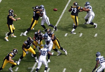 PITTSBURGH, PA - SEPTEMBER 18:   Ben Roethlisberger #7 of the Pittsburgh Steelers drops back to pass against the Seattle Seahawks during the game on September 18, 2011 at Heinz Field in Pittsburgh, Pennsylvania.  (Photo by Justin K. Aller/Getty Images)