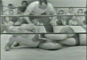 Buddy Rogers applying the figure four leg lock