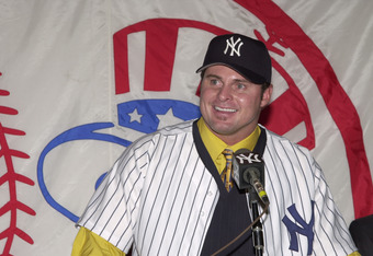 13 Dec 2001:  Jason Giambi fields questions from the media after signing a seven-year $120 Million deal with the New York Yankees at Yankee Stadium in New York. DIGITAL IMAGE  Mandatory Credit:  Lawrence Lucier/Allsport