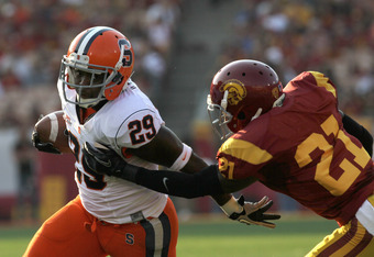 LOS ANGELES - SEPTEMBER 17:  Running back Antwon Bailey #29 of the Syracuse Orangemen carries the ball against cornerback Nickell Robey #21 of the USC Trojans at the Los Angeles Memorial Coliseum on September 17, 2011 in Los Angeles, California.  (Photo b