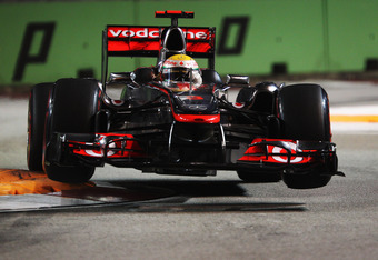 SINGAPORE - SEPTEMBER 24:  Lewis Hamilton of Great Britain and McLaren drives during the final practice session prior to qualifying for the Singapore Formula One Grand Prix at the Marina Bay Street Circuit on September 24, 2011 in Singapore.  (Photo by Ma