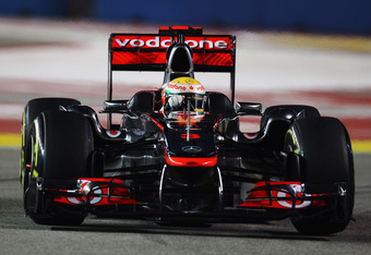 SINGAPORE - SEPTEMBER 24:  Lewis Hamilton of Great Britain and McLaren drives during qualifying for the Singapore Formula One Grand Prix at the Marina Bay Street Circuit on September 24, 2011 in Singapore.  (Photo by Vladimir Rys/Getty Images)