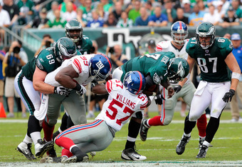 PHILADELPHIA, PA - SEPTEMBER 25:  Michael Vick #7 of the Philadelphia Eagles is sacked by Jacquian Williams #57 of the New York Giants at Lincoln Financial Field on September 25, 2011 in Philadelphia, Pennsylvania.  (Photo by Chris Trotman/Getty Images)