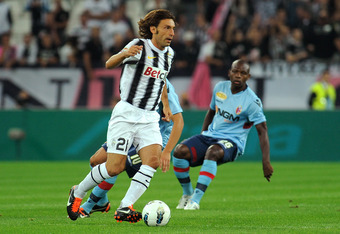 TURIN, ITALY - SEPTEMBER 21:  Andrea Pirlo of Juventus FC in action during the Serie A match between Juventus FC and Bologna FC on September 21, 2011 in Turin, Italy.  (Photo by Valerio Pennicino/Getty Images)