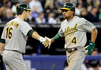 TORONTO, CANADA - APRIL 7: Coco Crisp #4 and Josh Willingham #16 of the Oakland Athletics celebrate run during MLB action between the Toronto Blue Jays and the Oakland Athletics at the Rogers Centre April 7, 2011 in Toronto, Ontario, Canada. (Photo by Abe